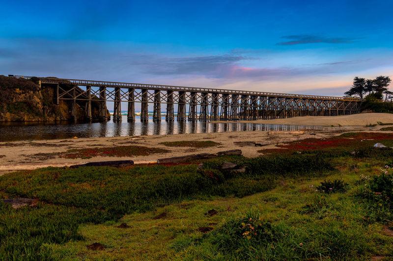 Bridge over land against blue sky