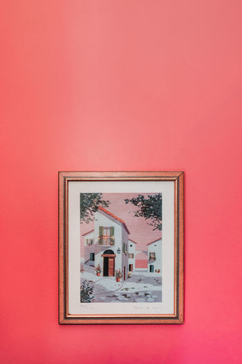 Close-up of pink painting on wall