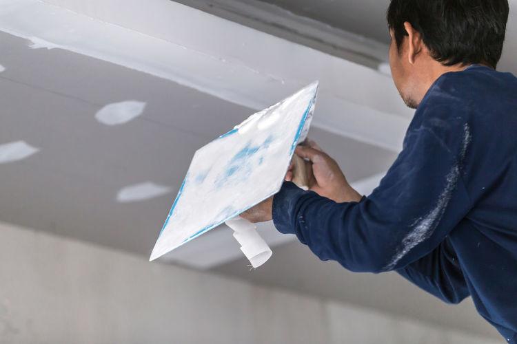 Plasterer repairing home
