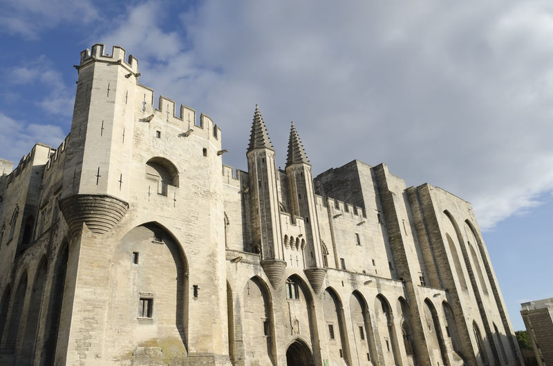 palace of the popes in Avignon, France Avignon France Palace Of The Popes Papal Palace Ancient Civilization Arch Architecture Belief Building Building Exterior Built Structure Cloud - Sky Day Gothic Style History Low Angle View No People Outdoors Place Of Worship Religion Sky Spirituality The Past