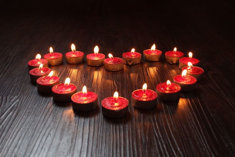 Close-up of candles on wooden table