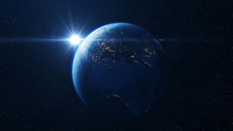 Digital composite of illuminated light against blue sky