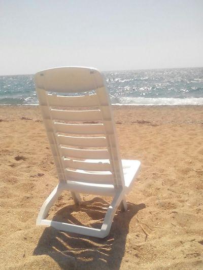 Relaxing Being A Beach Bum Sea Enjoying The Sun Sunshine Getting A Tan Blue Water Holidays Enjoying Life Beach Sand Water Reflections Sky