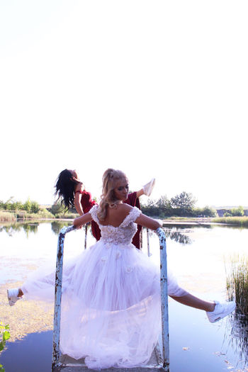 Water Sky Real People Women Lifestyles Wedding Nature Life Events Emotion Newlywed Celebration Event Clear Sky Leisure Activity Copy Space Wedding Dress Bride People Positive Emotion Outdoors