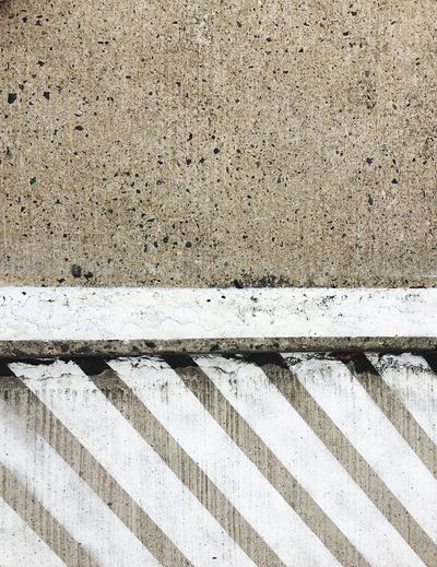 View From Above Copy Space Separated No Parking Barred Area Keepout Background Textures And Surfaces Diagonal Parallel Lines Pavement Patterns Pavement Sidewalk White Stripe Urban Geometry Striped Road Marking Outdoors Weathered Textured  Asphalt Day Close-up