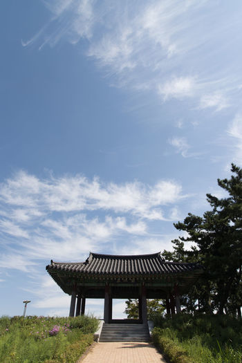view of Gomgaenaru, an old port at Geumgang River in Iksan, Jeonbuk, South Korea Architecture Geumgang Geumgang River Low Angle View Riverside White Clouds Architecture Beauty In Nature Blue Sky Built Structure Cloud - Sky Day Nature No People Outdoors Pavilion River Sky Tree