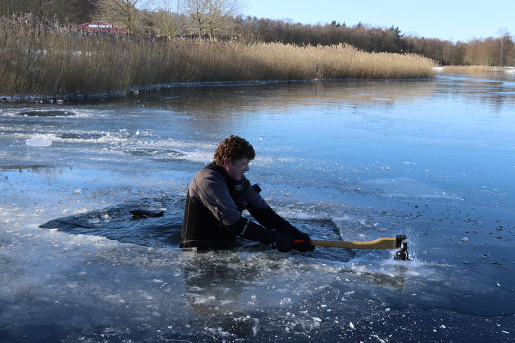 Side view of woman in lake during winter