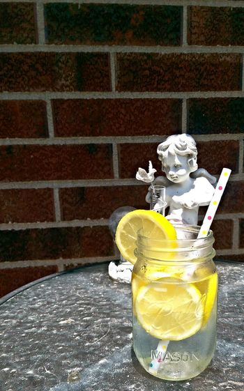 Lemon Water Glass Table Wall Brick