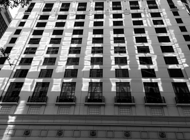 Gorgeous reflection of morning light Light And Shadow Morning Light Building Exterior Sun Spots Architecture Structures Orlando Florida Downtown Blackandwhite