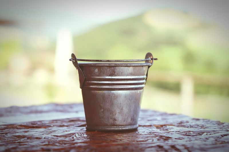 Close-up of bucket on table