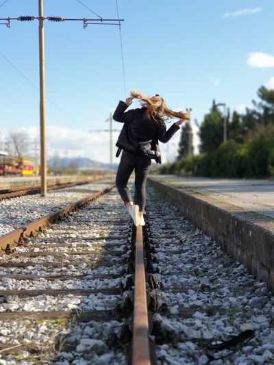 Women standing on railroad track