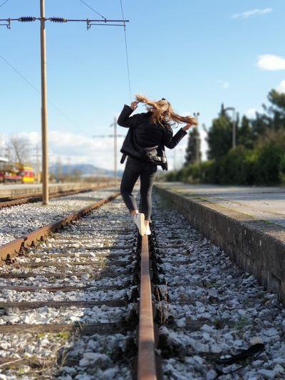 Women standing on railroad track