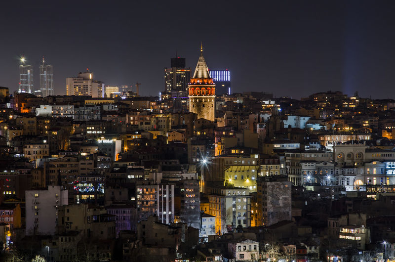 Illuminated Galata Tower In City At Night