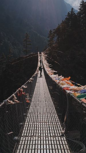 View of footbridge leading towards mountain