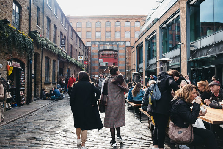 People walking inside Camden Market, London. Started with 16 stalls in March 1974, Camden Market is one of the busiest retail destinations in London. Architecture Building Exterior Group Of People Street Building Crowd Real People City City Life Large Group Of People Walking Lifestyles Day Footpath Outdoors Tourists People Leisure Activity Travel Destinations Europe England Market Famous Place Weekend Activities Trabel Camden Market, London Camden Town Uk London