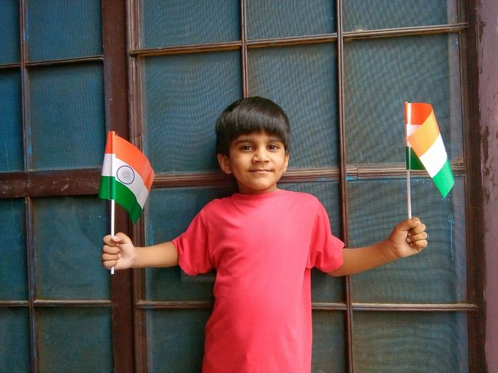 Indian boy holding national flag Window Young Boy Flag Indian Flag Indipendence Day Republic Day Confidence  Kid Indian Culture  Indian Colourful Tricolor Holding National Nation Nationalism Patriotism Patriotic Child Portrait Childhood Human Hand Looking At Camera Standing Males  Smiling Close-up Preschooler Innocence Exterior
