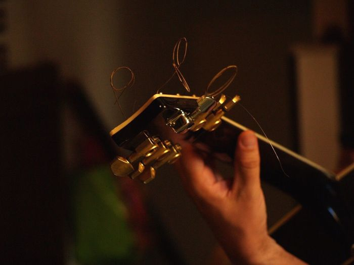 A friend's passion Human Hand Human Body Part Music Focus On Foreground Indoors  Holding Real People One Person Musical Instrument Arts Culture And Entertainment Close-up Musician Day People
