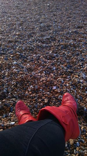 red boots,scuffed ,beach,pebbles ,close up,no people,legs,relaxing,outdoor, No Filter, No Edit, Just Photography Smartphone Photography Amateurphotography Coastline Beach St Leonards Leonards,Hastings,