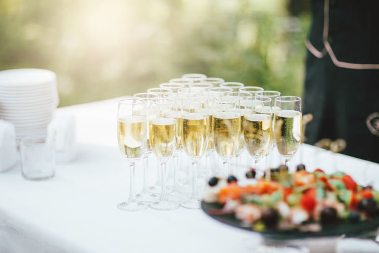 Glasses of champagne and snacks on the table at the event, catering