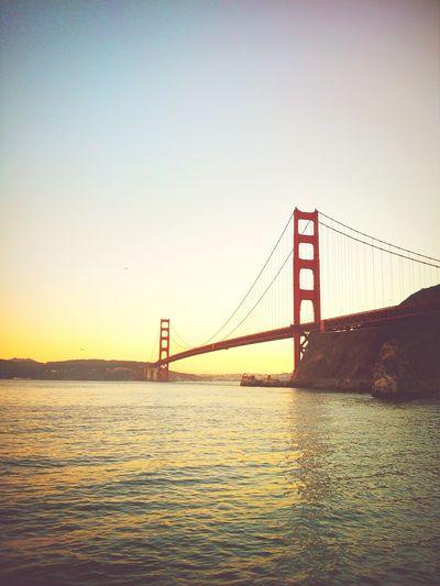 Golden gate bridge over bay against clear sky