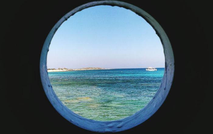 Circle Geometric Shape Window Sky Horizon Over Water No People Day Outdoors Greece Chrissiisland Toilets Around The World Toilet Window Sea Boot Water Beauty In Nature