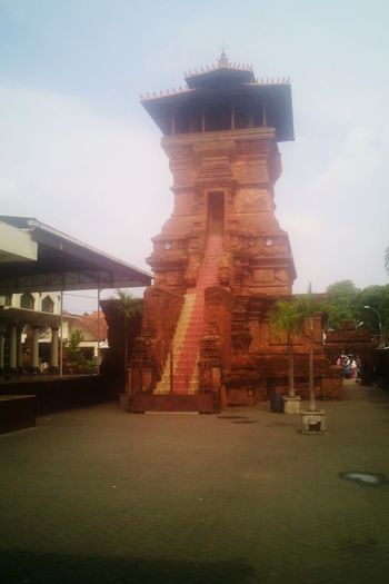 Travel Place Of Worship Religion Architecture Tourism Built Structure Travel Destinations Arts Culture And Entertainment Sunset Business Finance And Industry Sky Statue Outdoors No People Ancient Civilization Representing Cultures Day Beauty In Nature Nature Kudus City Indonesia Portrait Backgrounds