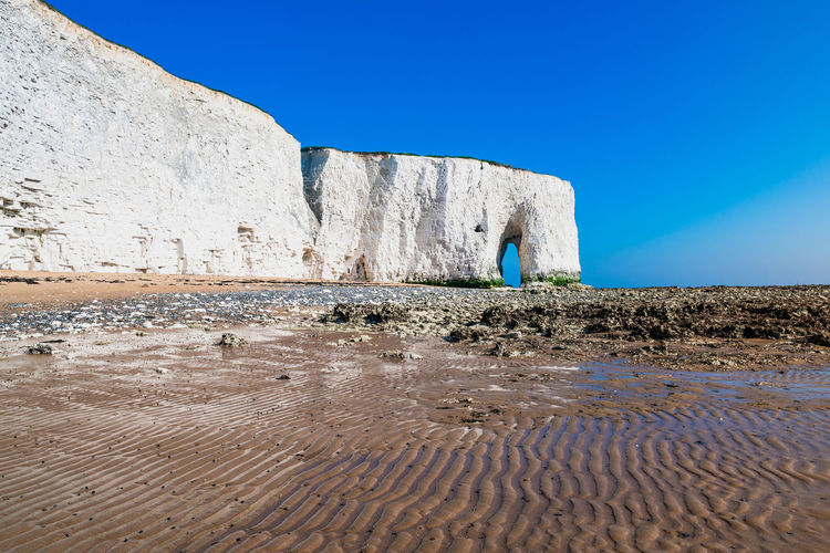 View of white cliffs and beach in Kingsgate Bay, Margate, East Kent, UK Chalk Cliffs Margate Beach Beauty In Nature Blue Chalk Clear Sky Day Kingsgate Bay Land Mountain Nature No People Non-urban Scene Outdoors Sand Scenics - Nature Sea Sky Solid Tranquil Scene Tranquility Water White White Cliffs