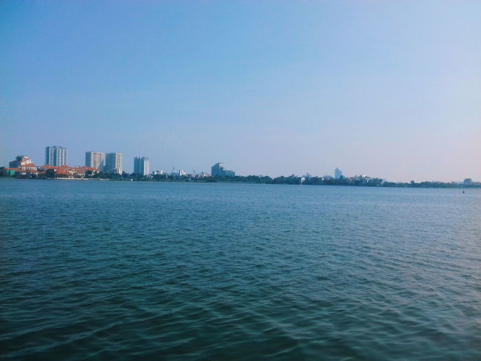 Afternoon Vscocam Sky Lake Lake View City Cityscape Urban Skyline Water Modern Skyscraper Clear Sky Downtown District Waterfront