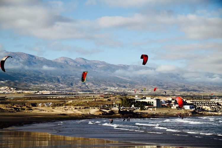 People kiteboarding in sea