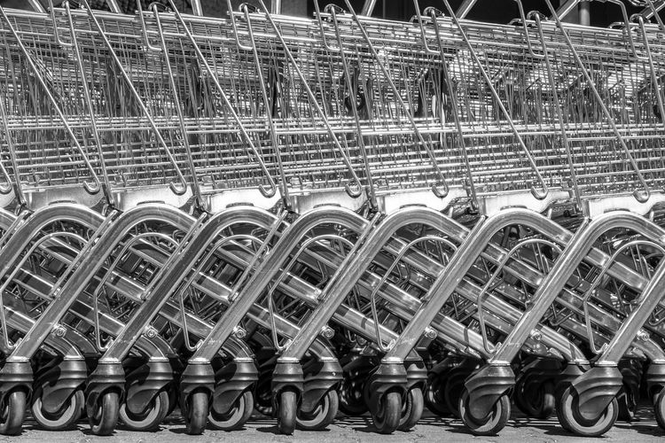Black & White Trolley Abundance Black And White Buggy Close-up Complexity Connection Convenience Day Full Frame In A Row Industry Large Group Of Objects Machinery Metal No People Outdoors Pattern Repetition Shopping Shopping Cart Side By Side Silver Colored Steel Technology Transportation Wheel