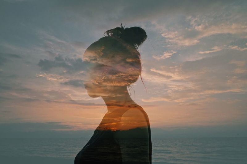 Sky Digital Composite Multiple Exposure Cloud - Sky Water Sunset Nature One Person Beauty In Nature Sea Silhouette Adult Outdoors Orange Color Young Adult Standing Waist Up Side View Contemplation