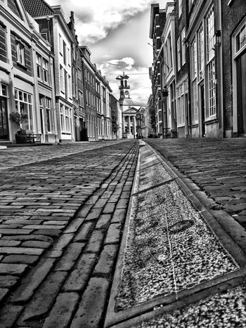 Architecture Building Exterior Built Structure Street Cobblestone City The Way Forward Building Surface Level Dordrecht Sky Residential Building Incidental People Transportation City Street Paving Stone City Life Outdoors Cloud Day