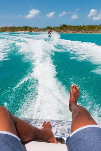 🌊 patiently waiting for a chance to skim across the surface 🚤~ Water Leisure Activity Personal Perspective Barefoot Beach Vacations Summer Wakeboat Wake Boarding Sony Tourism Tropical Climate Travel Destinations Godscreation Paradise Turksandcaicos Beauty In Nature Grandturk Nautical Vessel Vacations Done That.