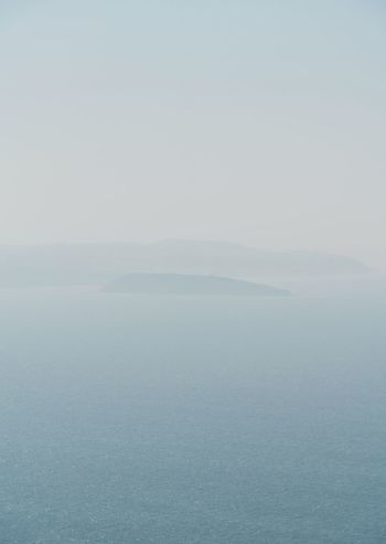 Faded Island Ocean Sea Wales Water Scenics - Nature Sea Tranquility Tranquil Scene Beauty In Nature Sky Nature Day Fog Blue Waterfront Horizon Over Water Horizon Outdoors