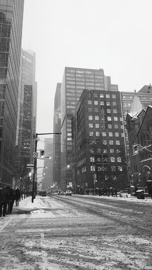Snowy commute home Pedestrians Commuters Simcoe Street King Street King And Simcoe Skyscraper Road Buildings Black And White Winter Snowy Day Toronto The 6ix Downtown Modern Downtown District