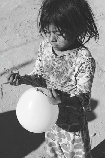 B&w side of the ballon of a child Our World Pma