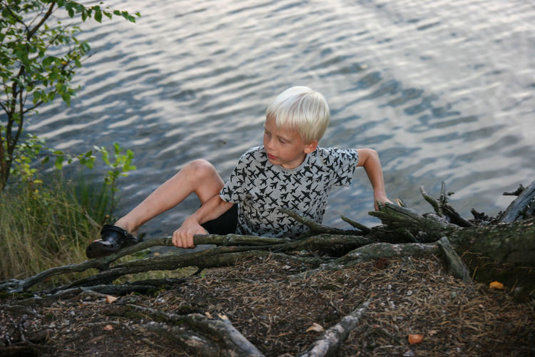 Boy climbing a rock