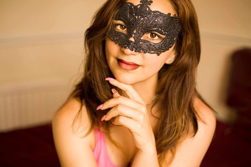 Portrait Of Woman Wearing Mask At Home