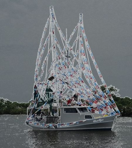 Amusement Park Ride Blessing Of The Boats Blue Capital Cities  City City Life Crabbing Vessel Boa Day Ghost Ship Illuminated Multi Colored Nature No People Outdoors Sky Tourism Travel Destinations Water