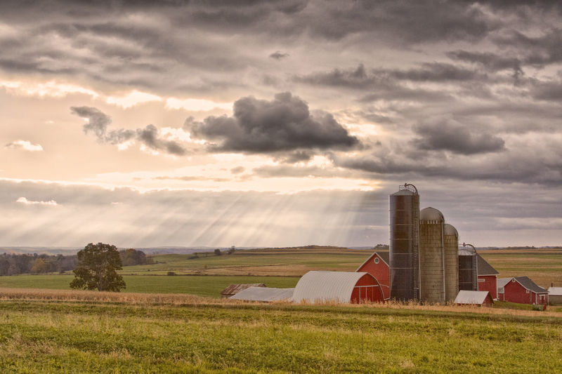 Just a peaceful Wisconsin farm sitting under a gorgeous sky Dramatic Sky Farm Farmland FlyOverState Light Rays Wisconsin Agriculture Cloud - Sky Grass Landscape Red Barn Rural Scene Silo