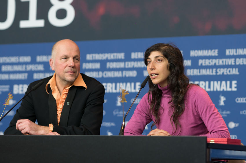 Berlin, Germany - February 24, 2018: Host Anatol Weber and Ines Moldavsky, winner of the Golden Bear for Best Short Film for the movie 'The Men Behind the Wall', at the Award Winners press conference AWARD Artist Berlin Event Film Festival Golden Bear Press The Media Winning Anatol Weber Arts Culture And Entertainment Berlinale Berlinale 2018 Berlinale2018 Berlinale68 Entertainment Entertainment Event Film Industry Front View Ines Moldavsky Mass Media Press Conference Prize Two People Young Adult