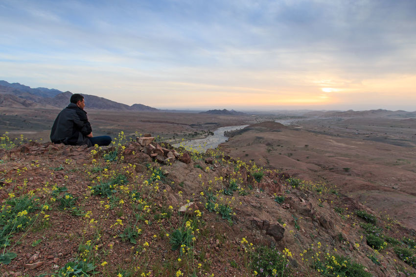 Feynan, Jordan - March 26,2015: Tourist watching the sunset from the mountains in the Feynan natural Reserve in Jordan ASIA Desert Feynan Jordan Landmark Middle East Safety Sky Sunset Tourist Touristis