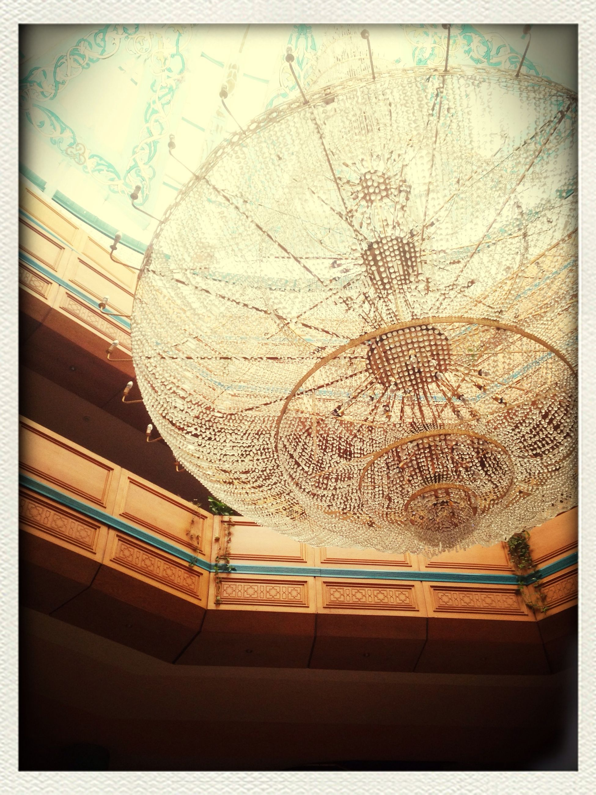 indoors, transfer print, auto post production filter, ceiling, architecture, built structure, pattern, low angle view, design, art and craft, glass - material, art, window, illuminated, creativity, ornate, lighting equipment, chandelier, close-up, decoration
