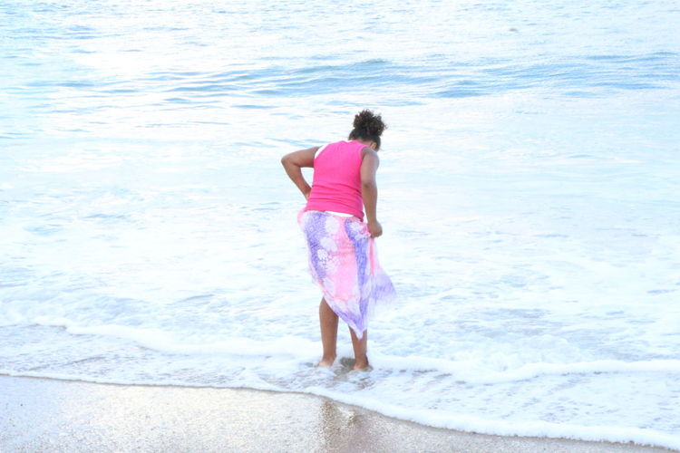 Innocence Beach Carefree Casual Clothing Day Enjoyment Full Length Getting Away From It All Leisure Activity Real People Sand Standing Vacations Young Women