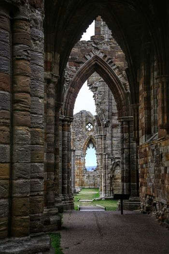 Whitby Whitby Whitby Abbey Architecture Arch Built Structure The Past History The Way Forward Day Direction Travel Destinations No People Old Building Tourism Religion Ancient Nature Arcade Travel Building Exterior Abbey Outdoors Architectural Column Ancient Civilization Colonnade