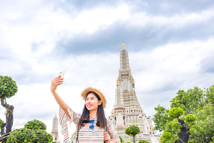 Asian  Buddha Pagoda Taking Photos Thailand Travel Woman Young Attractions Backpacker Female Landmark Mobile People People Photography Picture Portrait Relax Religion Selfie Smartphone Smile Temple Tourism Vacation