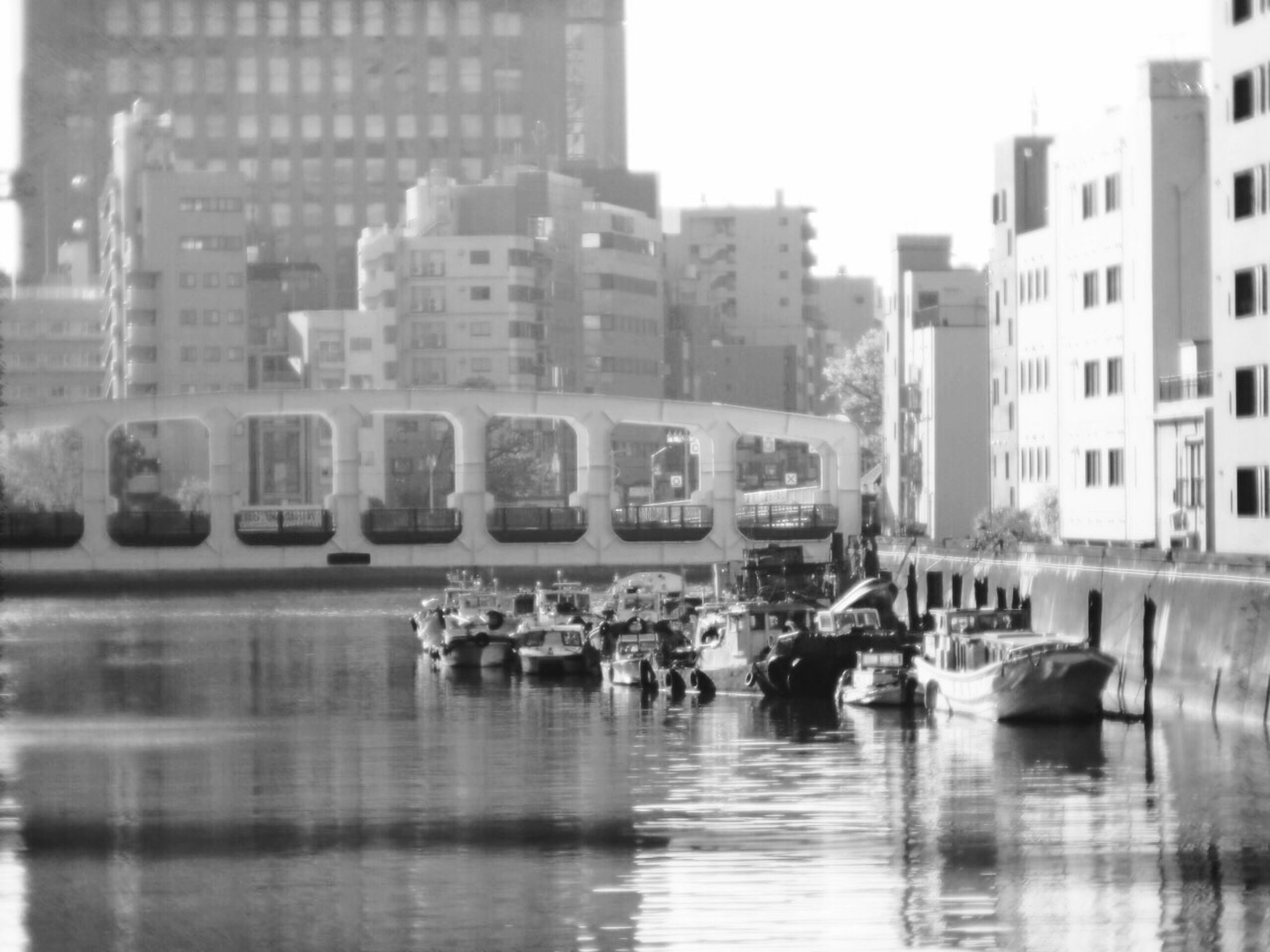 building exterior, transportation, architecture, water, built structure, mode of transport, nautical vessel, reflection, waterfront, boat, city, moored, canal, clear sky, building, city life, travel, sky, incidental people, day