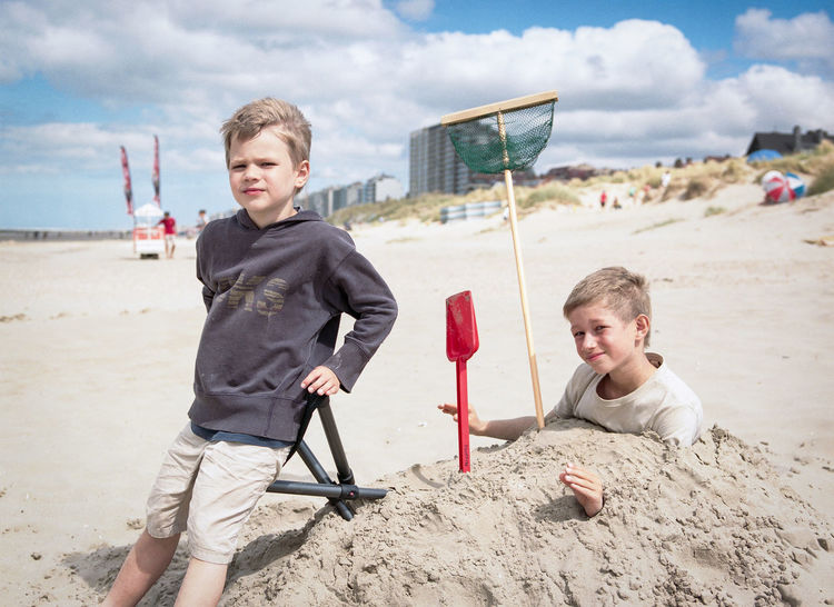 Beach Boys Happiness Leisure Activity Live For The Story Looking At Camera Outdoors Playing Portrait Sand Sand Pail And Shovel Sea Sky Smiling Standing Summer Summertime Sunny Vacations