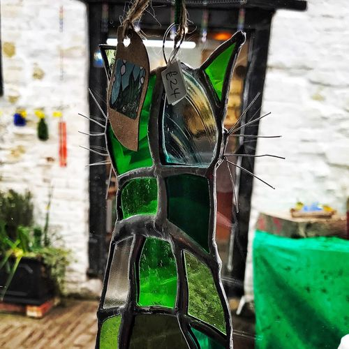 Stained glass cat No People Hanging Day Outdoors Multi Colored Green Color Close-up Building Exterior Stained Glass Looking Through Window Green Art And Craft Artist