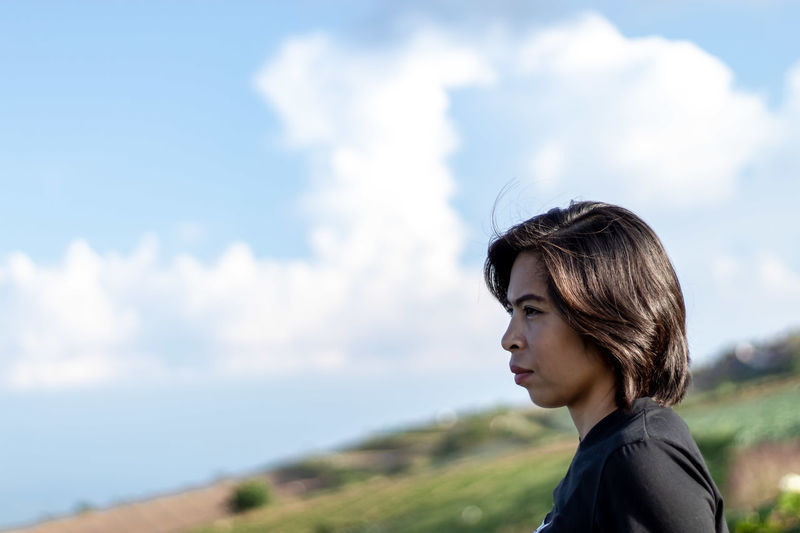 Portrait One Person Cloud - Sky Sky Headshot Contemplation Looking Adult Young Adult Nature Side View Hair Focus On Foreground Hairstyle Looking Away Day Copy Space Women Environment Profile View Outdoors Wind Beautiful Woman